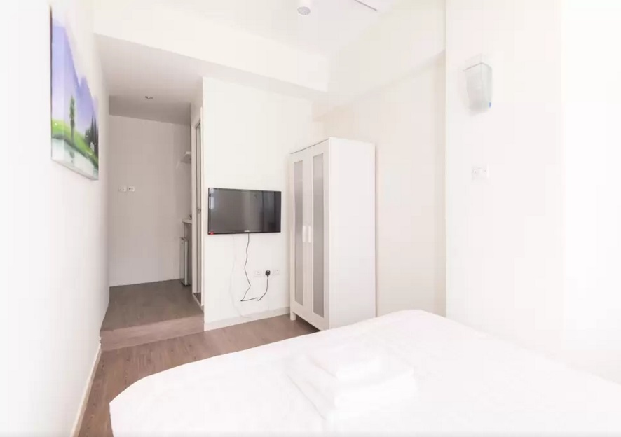 serviced apartment bedroom with TV